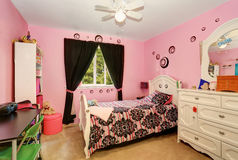 Beautiful girls room in bright pink color with carved wood bed Stock Photos