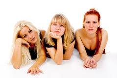 Beautiful girls sad watching TV. On white background Stock Photo