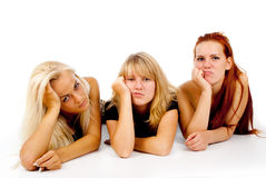 Beautiful girls sad watching TV. On white background Stock Photos