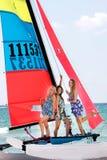 Beautiful girls on sea catamaran Stock Photo