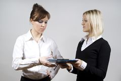 Beautiful girls send documents to each other Stock Image