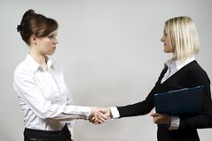 Beautiful girls shaking hands on Royalty Free Stock Photo