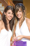 Beautiful girls with shopping bags Royalty Free Stock Photo