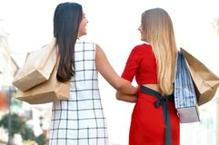 Beautiful girls with shopping bags royalty free stock photography
