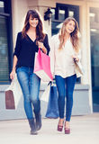 Beautiful girls with shopping bags Stock Photos