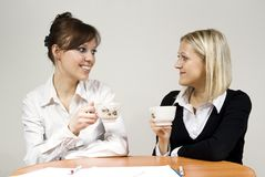 Beautiful girls smiling drink tea Royalty Free Stock Photography