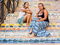 Beautiful girls on the stairs decorated with ceramic tiles Royalty Free Stock Image