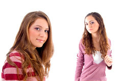 Beautiful girls standing in front of camera Royalty Free Stock Images