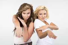 2 Beautiful girls strike a crazy pose Stock Image