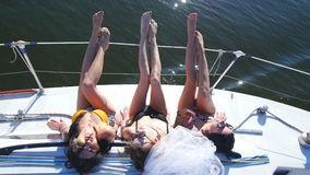 Beautiful girls sunbathing on a yacht - party and bachelorette party.  stock video