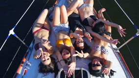 Beautiful girls sunbathing on a yacht - party and bachelorette party.  stock footage