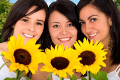 Beautiful girls, sunflowers Royalty Free Stock Images