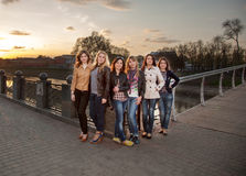 Beautiful girls at sunset. Beautiful girl standing on the bridge at sunset Royalty Free Stock Images