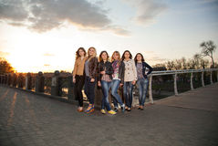 Beautiful girls at sunset Stock Photo