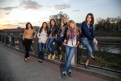 Beautiful girls at sunset. Girls on the banks of the river at sunset Royalty Free Stock Images