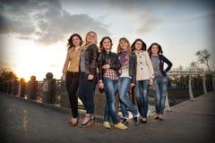 Beautiful girls at sunset Stock Image