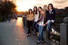 Beautiful girls at sunset Stock Photo