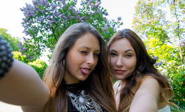 Beautiful girls taken picture of herself, selfie. Royalty Free Stock Photography