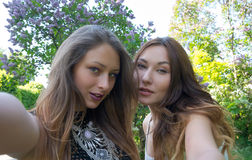 Beautiful girls taken picture of herself, selfie. Stock Image