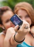Beautiful girls taking photo a camera Stock Image