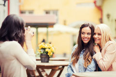 Beautiful girls taking picture in cafe in city Royalty Free Stock Photos