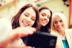 Beautiful girls taking picture in cafe in city Stock Image