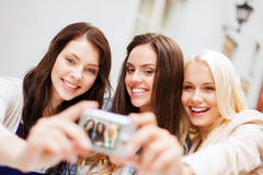 Beautiful girls taking picture in the city Royalty Free Stock Image