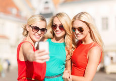Beautiful girls taking picture in the city Stock Photos