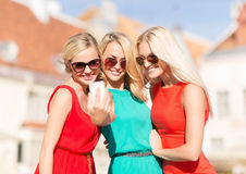 Beautiful girls taking picture in the city Stock Images