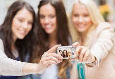 Beautiful girls taking picture in the city Royalty Free Stock Photo