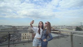 Beautiful Girls Taking A Selfie On The Roof stock video footage