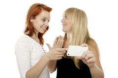 Beautiful girls talking about something at phone Royalty Free Stock Images