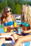 Beautiful girls talking on summer beach Stock Photography