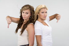 2 Beautiful girls with thumbs down Stock Photo