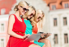 Beautiful girls toursits looking into tablet pc Royalty Free Stock Photography
