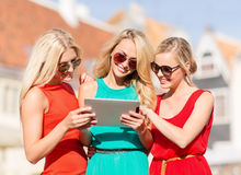Beautiful girls toursits looking into tablet pc Stock Image