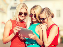 Beautiful girls toursits looking into tablet pc Stock Images