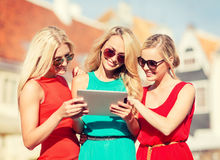 Beautiful girls toursits looking into tablet pc Royalty Free Stock Photos