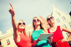 Beautiful girls toursits looking into tablet pc Royalty Free Stock Images