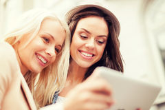 Beautiful girls toursits looking into tablet pc Royalty Free Stock Image
