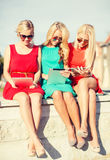 Beautiful girls toursits looking into tablet pcs Royalty Free Stock Photography