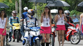 Beautiful girls on track. A race won't be a race without beautiful girls flaunting their stuff on track.Malaysian cubprix competition 2009 in kuching sarawak Royalty Free Stock Photo