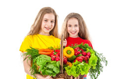 Beautiful girls with vegetables Stock Photos