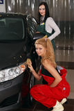 Beautiful girls wash cars Stock Images