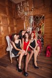 Beautiful girls on a wooden background. Celebrate the birthday. Royalty Free Stock Images