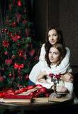 Beautiful girls in woolen sweaters near stock image