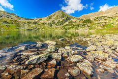 Beautiful glacier lake and colorful stones,Retezat mountains,Transylvania,Romania Royalty Free Stock Photos