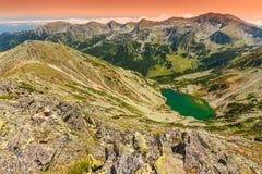 Beautiful glacier lake in high mountains,Taul Tapului Lake,Retezat mountains,Romania Stock Photos