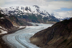 A beautiful glacier winding down a moutain Stock Image