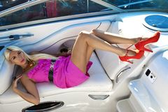 Blond Woman in pink dress on Boat, Summer royalty free stock photo